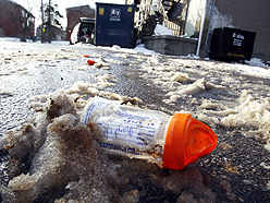 A medical vial from a methadone clinic sits in a laneway behind a strip mall on Eglinton Ave. E. and Brimley Rd.